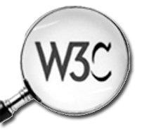 Sigle W3C agrandi sous un loupe